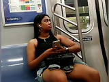 Beautiful black Asian dark thick legs in shorts on the train